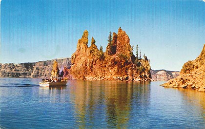 "A postcard image of ""The Phantom Ship,"" a rocky island tucked at the back of the lake."