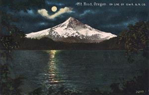 Mount Hood as seen across Lost Lake by moonlight, pictured on a postcard dating from circa 1930