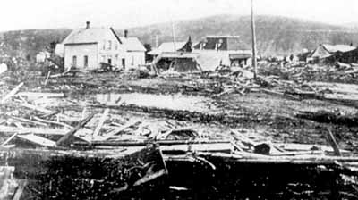 The Heppner methodist church stands like a sentinel guarding the wreckage of its town after the 1903 flood.