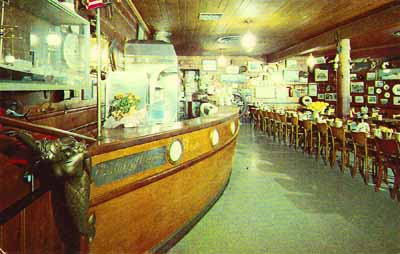 1950s postcard view of Dan and Louis's Oyster Bar in downtown Old Town Portland. The Brother Jonathan's wheel can be seen at the end of the bar.