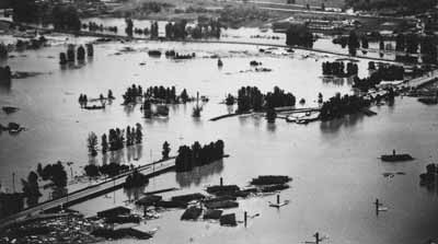 Buildings floating in an aerial view of the Vanport flood.