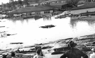 Buildings float during Vanport flood in 1948.