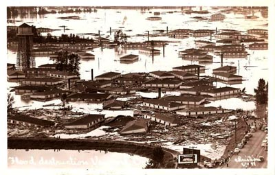 Postcard showing floating  buildings in Vanport flood 1948.