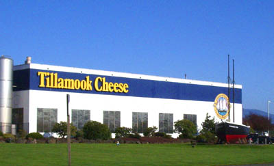 Tillamook Cheese factory, prominently featuring a small black schooner that's a replica of the Morning Star, the ship that Tillamook settlers built