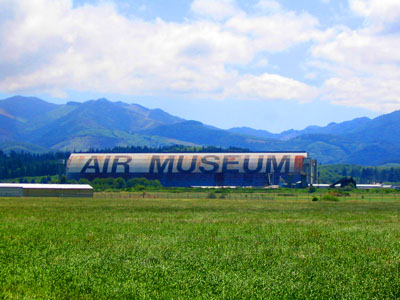 "World War II-era blimp hangar near Tillamook, home of the Tillamook Air Museum, shares the title of ""largest clear-span wooden building"" with several other blimp hangars of the same design."