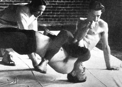 Robin Reed pinning a teammate at Oregon State (then OAC) in the 1920s.