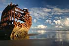 The remains of the barque Peter Iredale as they appear today, jutting out of the beach sands on Clatsop Spit at Warrenton as they have since 1906. In 1960, the wreck nearly was lost to a man who claimed he owned it.