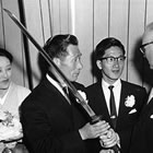 Retired aviator Nobuo Fujita presents his family's 400-year-old sword to Brookings Mayor Fell Campbell as his wife, Ayako, and son, Yasuyoshi, look on. (Image: William McCash/ Bombs Over Brookings book)