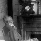 Former slave Louis Southworth relaxes at his home; the violin with which he earned his freedom is perched atop the clock on the mantle.