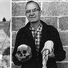 Howard A. Black, the curator of the Grant County Museum in Canyon City, shows the skull of murderer Berry Way, hanged for murder near Canyon City in 1864 – the same year hot-tempered 15-year-old Hank Vaughan shot two people in Canyon City. Had Hank's aim been better, this would likely have been his fate as well. (Image: Ben Maxwell/ Salem Public Library)