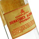 This is the type of bottle in which denatured alcohol was sold out of drugstores during Prohibition. The large, scary labels notwithstanding, the vast majority of denatured alcohol sold in bottles of this size was used for drinking, despite its terrible flavor and toxic additives.