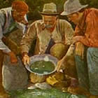 A turn-of-the-century hand-tinted postcard image of three happy miners gazing at gold nuggets in a mining pan.